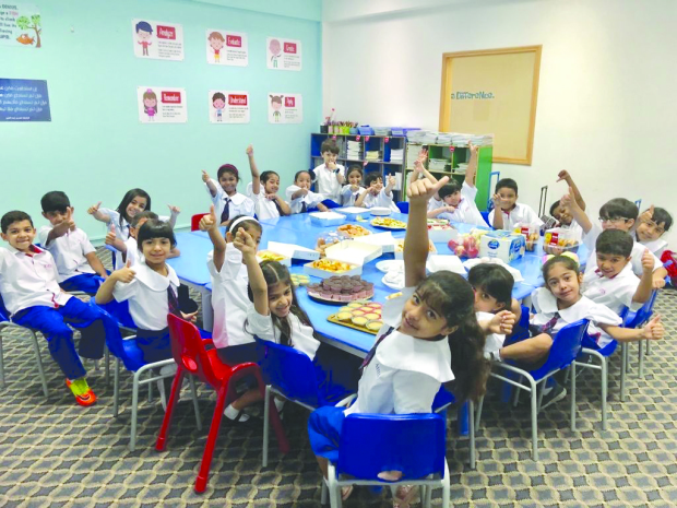 <p>Students from Al Hekma International School celebrated World Food Day under the theme 'Zero Hunger'. Grade one students brought food from home, packed them in boxes which were presented to gym workers and cleaners in the school. The children were also briefed on hunger around the world and the need to work together to eradicate it. Above, the children making food packets.</p>
