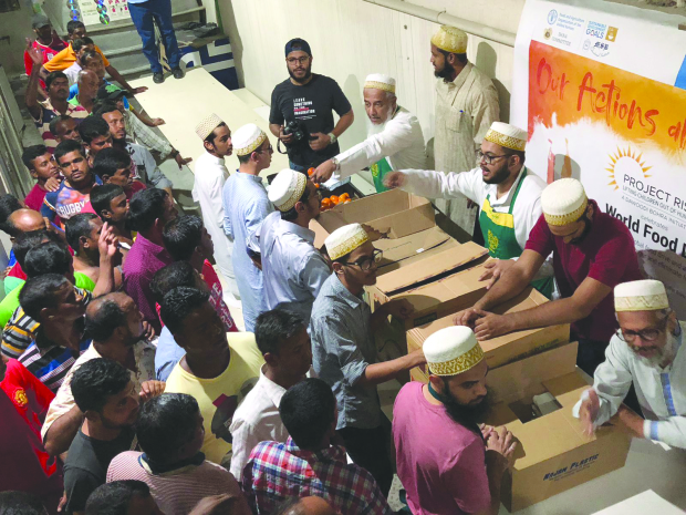 Around 1,275 labourers were presented with food packets and items to mark World Food Day. The donations, made by the Dana Committee of the Jamiat Al Bohra in Bahrain, included 800 biryani packets, 300kg rice, 150 litres of oil, 300kg sugar, 150kg wheat flour, 240 litres of milk, milk powder, coffee, canned fruits and jam. The meals and provisions were distributed in labour camps in Askar, Sanad, Tubli, Eker and in Hidd. Above, labourers receiving the food packets.