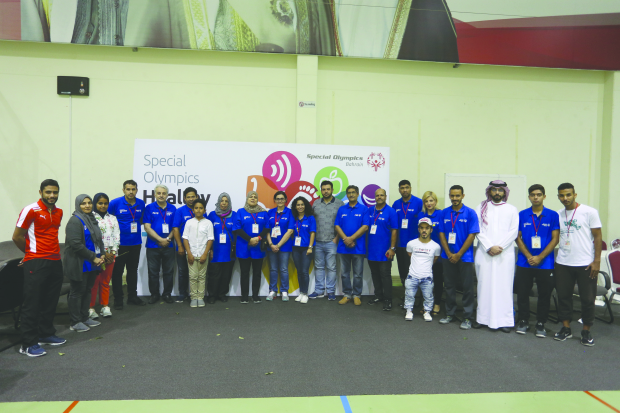 <p>Eighty people with disabilities were provided with free medical check-ups at Alba Club, Buhair. The event, organised by Bahrain Special Olympics, included dental, eye and organs tests by six Arab and six Bahraini volunteer doctors. Above, participants at the camp with officials.</p>