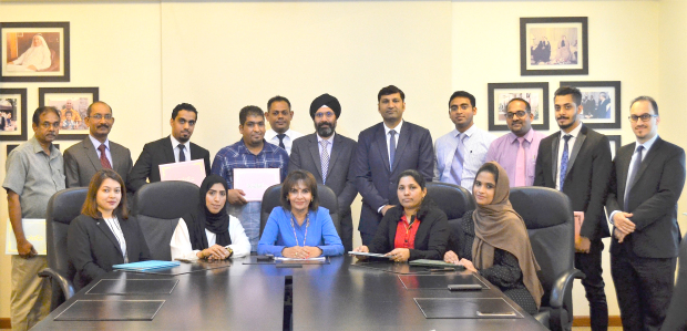 Twelve Y K Almoayyed and Sons employees from various divisions were honoured for their excellent performances. Managing director Mona Almoayyed presented them with certificates. Above, Ms Almoayyed, seated, centre, with chief executive Alok Gupta, standing, fifth from right, human resources and total quality management group manager Sonu Duggal, standing, centre, with the honoured employees.