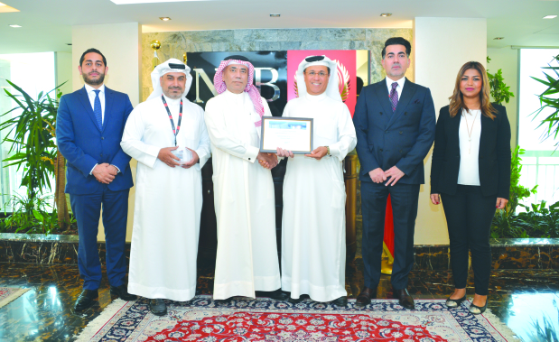 <p>National Bank of Bahrain (NBB) has received a special award from Citi Bahrain for leadership in the payment space. The Citi 2017 Performance Excellence Award is an honour presented to leading financial institutions worldwide, for achieving high rates of Straight-Through Processing (STP). NBB achieved a Treasury STP rate of 99 per cent and Commercial STP rate of 95pc during 2017. Citi Group correspondent banking director Abdul Mohsin Al Mahdi presented the award to NBB chief executive for treasury, capital markets and wealth management Hussain Al Hussaini. NBB head of coverage, corporate and institutional investment banking Ali Abdulkarim; relationship manager financial institutions Amal Safar; head of treasury operations Nabeel Kazim; and Citi head of financial institutions, Bahrain and Kuwait, Omar Kopti were present.</p>