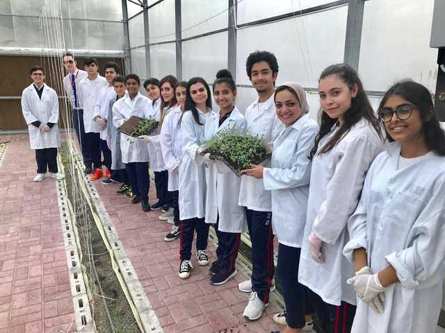 'Go Green' committee members of Al Hekma International School started planting saplings inside the school's greenhouse
