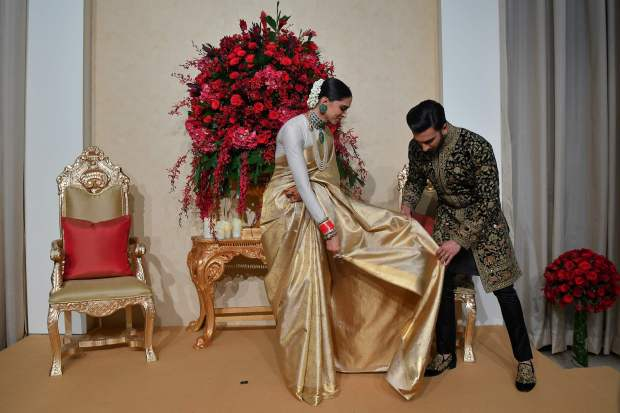 Bollywood: PHOTOS: Looking their regal best, Deepika-Ranveer at Bengaluru reception