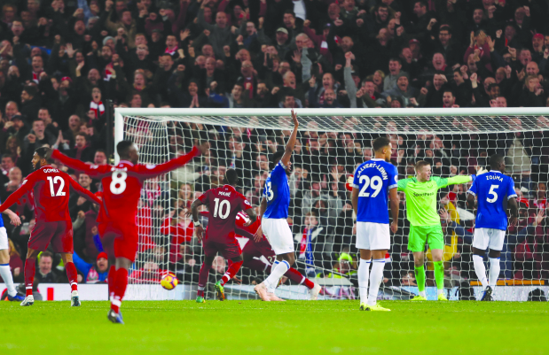English Premier League: Liverpool win with freak injury-time goal