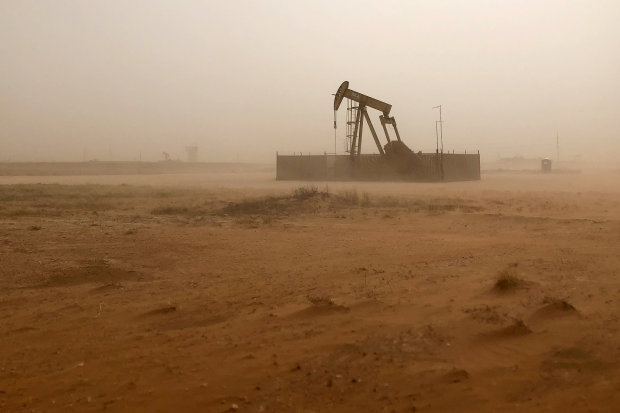 Oil prices sag on weak stock markets, but traders keep eye on OPEC meeting