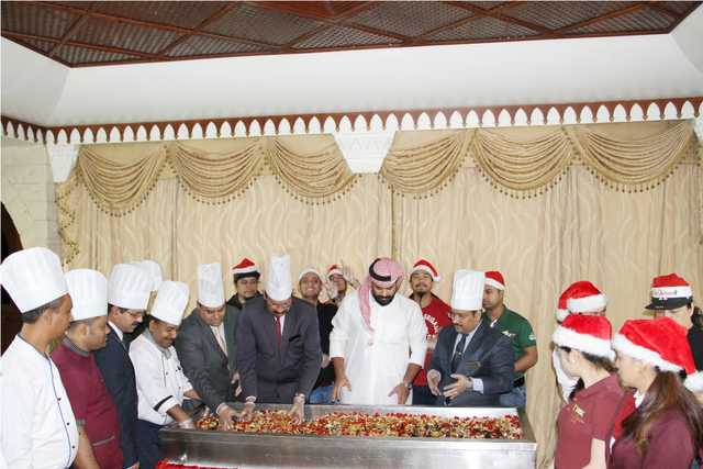 Photo Gallery: Delmon International Hotel held a traditional cake