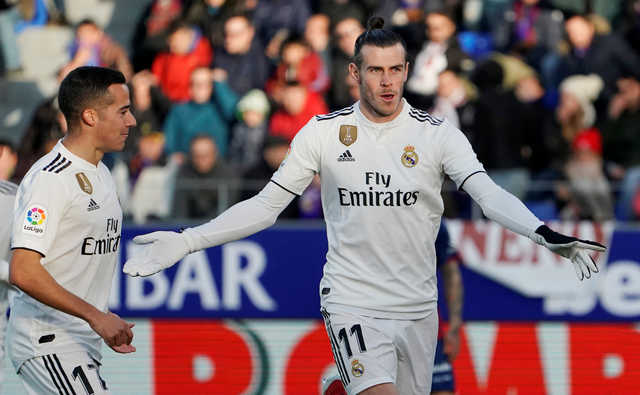 Bale shines as Real edge out Huesca