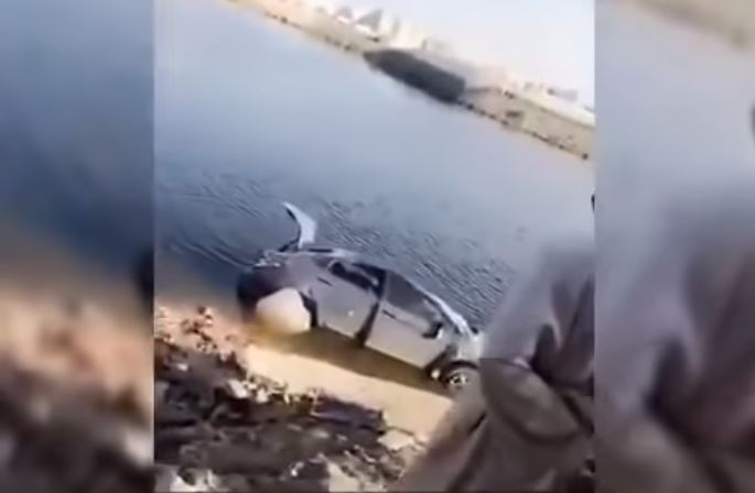 Car drives off flyover, plunges into lake as female driver loses control