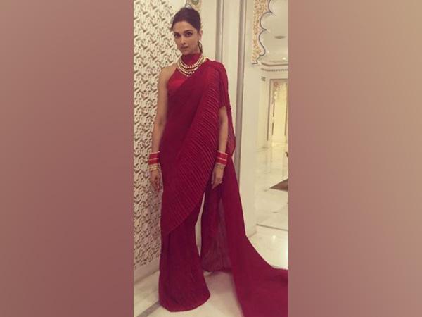 Deepika stuns in red at Isha Ambani's pre-wedding ceremony