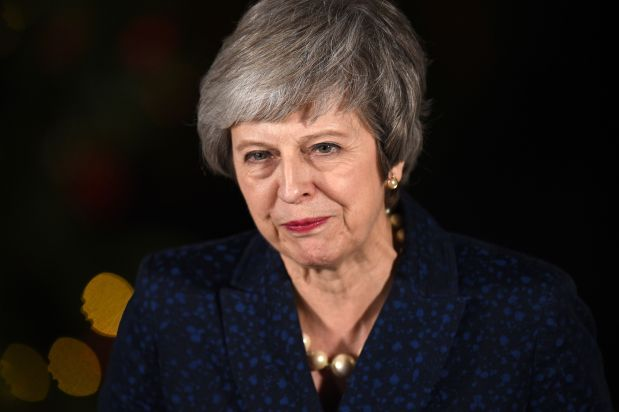 UK's May says will deliver on Brexit after surviving confidence vote