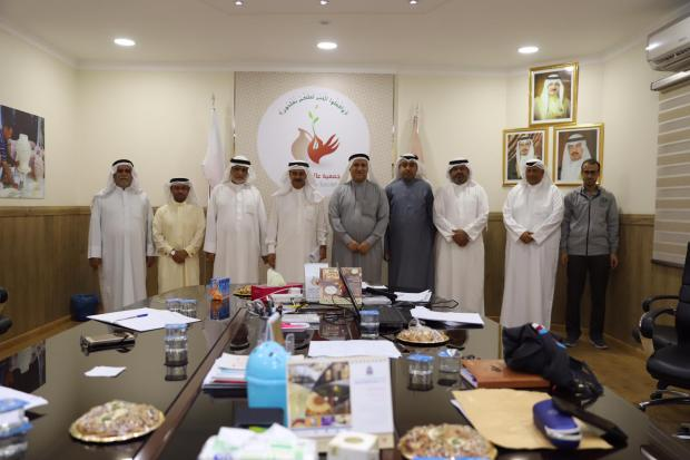 Mr Al Sitri, centre, Mr Al A'ali, fourth from left, with society board members following the meeting