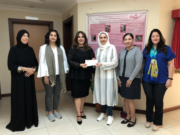 <p><em>The cheque presented by AWA community service chairwoman Laila Hussain, third from left, to Al Wafa Centre supervisor Khatoon Al Ameer</em></p><p>Donations were presented by the American Women's Association (AWA) to two local societies. </p><div>AWA members visited the Bahraini Association for Intellectual Disability and Autism (Al Wafa Centre) in Isa Town and presented them with a cheque for BD650, which will go towards the purchase of playground equipment. </div><div><br></div><div>Another cheque for BD1,000 was also presented to the Friendship Society for the Blind in support of its projects. </div><p><em><br></em></p>