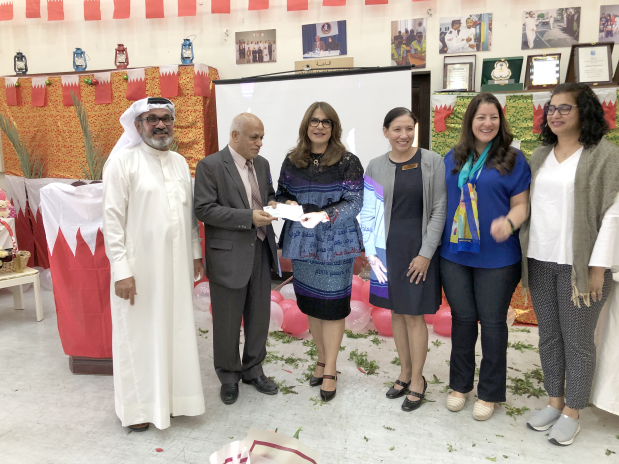 <p><em>The cheque presented by AWA community service chairwoman Laila Hussain, third from left, to Friendship Society for the Blind chairman Hussain Al Hulaibi</em></p>
