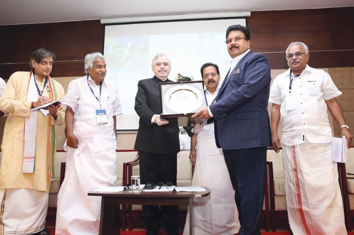 <div>Indian state of Kerala's governor P Sathasivam presented the Rajiv Gandhi Institute of Development Studies (RGIDS) award for socially responsible entrepreneur to Bahrain-based businessman Varghese Kurian, VKL Group chairman, in the presence of MP Shashi Tharoor, former chief minister Oommen Chandy and leader of opposition Ramesh Chennithala at Thiruvanathpuram. The governor inaugurated a conclave organised by the RGIDS on the theme 'Rebulding Kerala: The Way Forward'.</div>