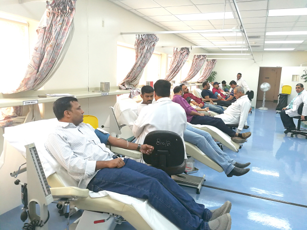 <p><em>People donating blood</em></p><p>More than 75 people donated blood at a camp hosted at Salmaniya Medical Complex. </p><div>The event, organised by the Facebook community Bahrain Different Thinkers (BDT), saw the participation of expats and citizens. </div><div><br></div><div>The blood collected was donated to the hospital's blood bank. S A Al Haddad and Bros vice chairman Abdulla Al Haddad was presented with a memento in gratitude of his support to the BDT. </div><p><em><br></em></p>