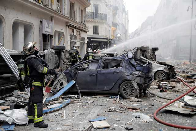World News: PHOTOS: Two firefighters killed in Paris bakery explosion