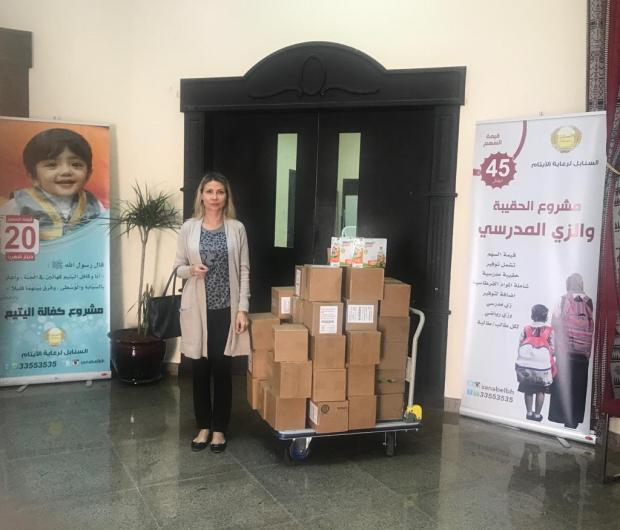 <p><em>Company's founder Irina Duisimbekova Katrangi at the society with the donation</em></p>
