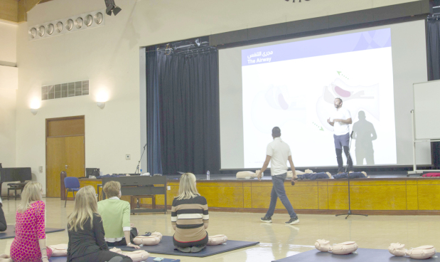 <p><em>The training session in progress</em></p> <p>A total of 259 staff members of St Christopher's School attended a 90-minute workshop organised by the Royal Life Saving Bahrain (RLSB).</p> <div>Topics includedchainof survival, primary assessment (checking for breathing), cardiopulmonary resuscitation, automated external defibrillation, management of choking and recovery position.</div> <div></div> <div>The school has partnered with the RLSB to provide specialised first-aid courses to equip staff with the skills and knowledge to be able to take control of potentially life-threatening emergencies until professional aid arrives.</div> <p><em><br /></em></p>