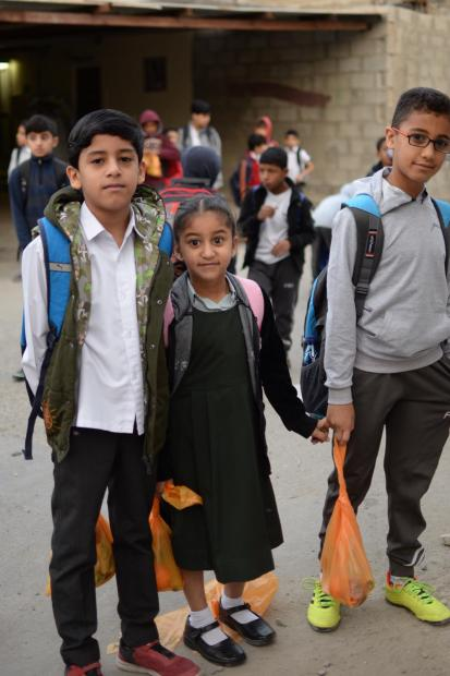 <p><em>Children with their breakfast parcels</em></p><p>Hundreds of students fromJanussanwere treated to a healthy breakfast as well as red flowers.</p><p>JanussanCharity Society distributed meals to more than 500 students, who returned to school at the start of the second term.</p><p>Society chairman Hussein Al Sabbagh said they started distributing parcels at 5.30am as the students boarded school buses.</p>