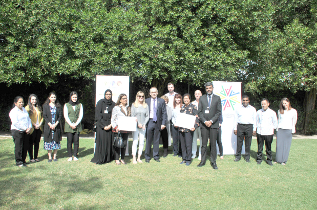 <p><em>Mr Martin, eighth from left, and his wife with officials and charity representatives</em></p> <p>A total of BD1,034 has been donated to two local organisations that focus on helping labourers in Bahrain.</p> <p>The money was raised by the British Embassy during a charity carol concert in December.</p> <p>Cheques were presented to the Migrant Workers Protection Society and Conserving Bounties by UK Ambassador Simon Martin and his wife Sophie at the embassy in Manama.</p> <p>Conserving Bounties specialises in collecting and packing surplus food from hotels, restaurants and private occasions for distribution to the needy, while the MWPS campaigns on behalf of expatriate workers.</p> <p>Each organisation received BD517.</p>