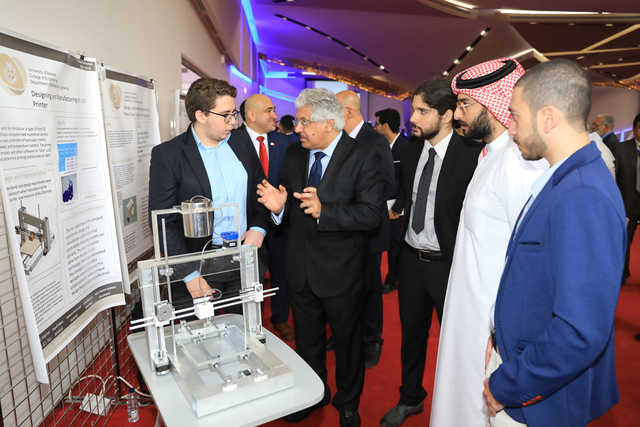 <p><em>Dr Hamza, third from left, speaking to one of the students about his project</em></p> <p><em><br /></em></p> <p>Sixty-two outstanding engineering projects were showcased at the Graduation Projects Exhibition of the College of Engineering at Bahrain University.</p> <p>President Dr Riyadh Hamza said the university continued to keep up with the market demands by launching academic programmes that served different sectors and stimulates sustainable development. He also handed out trophies and certificates of appreciation to the participating students.</p> <p><em><br /></em></p>