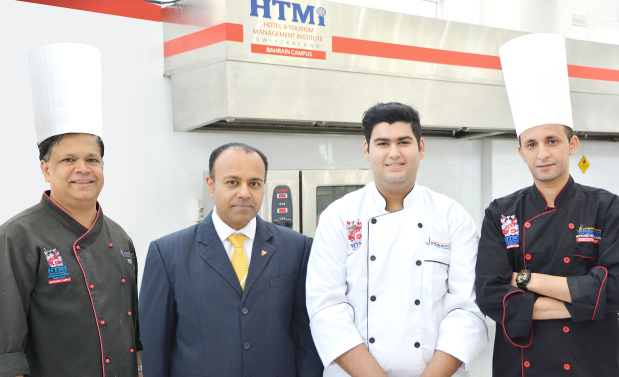 <p><i>At the event are, from left, BIHR trainer chef Sadanand Gowda, executive director Nigel Viegas, Mr Al Awadhi and trainer chef Mohamed Becherreguen.</i></p> <p>Ahmed Mustafa Al Awadhi, a 19-year-old Bahraini and student of Bahrain Institute of Hospitality and Retail's (BIHR) Swiss Diploma in International and Tourism Management Programme, represented the country at the fifth edition of International Young Chef Olympiad.</p> <div>At the event held in India, Mr Al Awadhi competed with young chefs from 55 countries representing the world's best culinary and hospitality institutions.</div> <div></div> <div>His participation was fully sponsored by Dadabai Holding.</div>