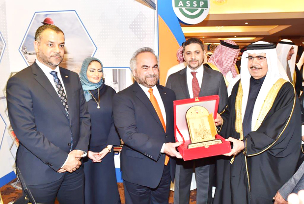 <p><em>Gen Shaikh Rashid, right, receiving a memento from Dr Jawahery, third from left, at the GPIC pavilion</em></p> <p>Interior Minister General Shaikh Rashid bin Abdulla Al Khalifa visited the Gulf Petrochemical Industries Company (GPIC) pavilion at the 13th Professional Development Conference, organised by the American Society of Safety Professionals.</p> <div>He was received by GPIC president Dr Abdulrahman Jawahery and members of the executive management.</div> <div></div> <div>He praised the company's achievements and contributions. More than 600 delegates took part in the conference and its accompanying exhibition.</div> <p><em><br /></em></p>