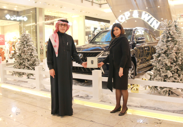 <p>Bahraini Ahlam Al Kooheji, right, has won a brand new Lexus LX570s in a raffle organised by City Centre Bahrain as part of its10th anniversarycelebrations.</p> <div>She was handed the keys to her new vehicle by senior mall manager Duaij Al Rumaihi, left.</div> <div></div> <div>Shoppers were entered into the draw for every BD30 spent during the promotion.</div> <p><em><br /></em></p>