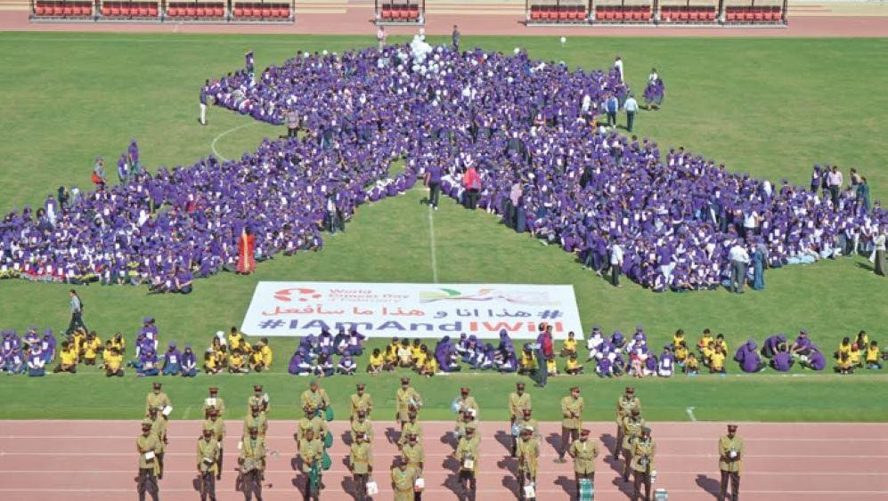 2,700 school children form human ribbon to mark World Cancer Day