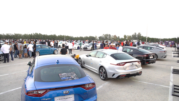 <p>Motorsport enthusiasts have a look at the cars on display.</p>