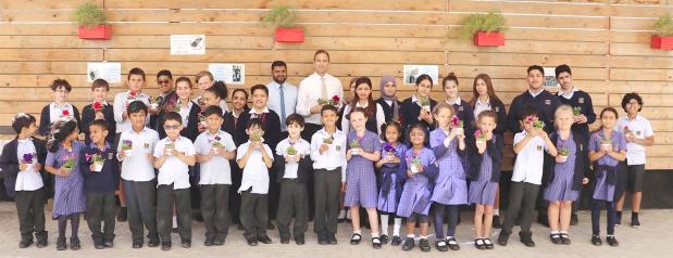 <p>Schoolchildren with plants at Lulu Hypermarket.</p>