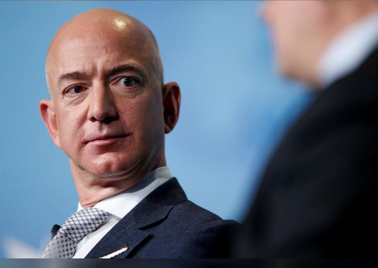 Amazon's Bezos says National Enquirer owner tried to blackmail him
