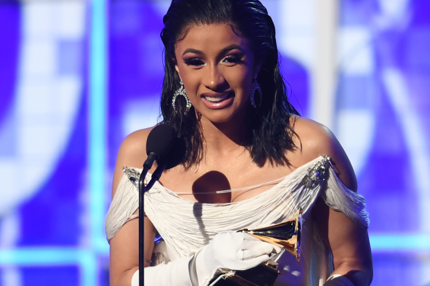Women reign at glitzy Grammys gala that also makes rap history