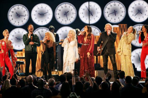 Celebs: Women reign at glitzy Grammys gala that also makes rap history