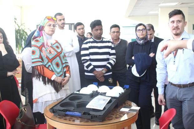 <p>Mr Phelan, right, with workshop participants.</p>