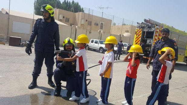 <p>Students trying their hands on a fire hose.</p>