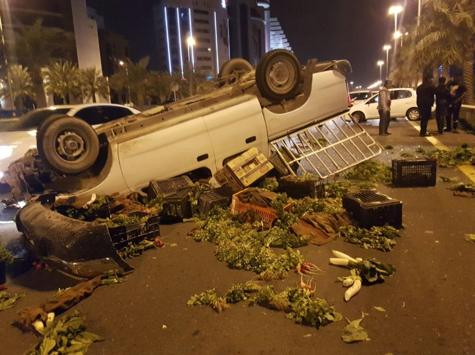 Pick-up truck carrying vegetables overturns