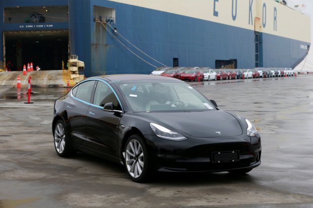 Tesla rolls out Model 3 in China