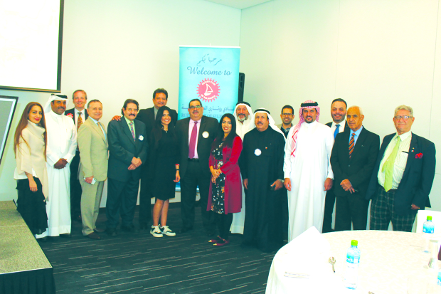 <p><em>Ms Alshaiba, seventh from left, with club members at the event</em></p>