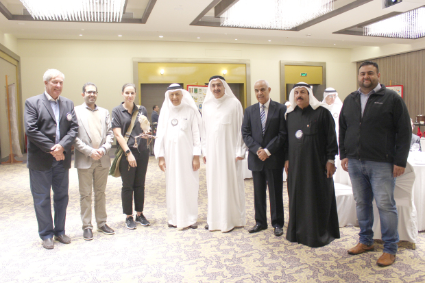 <p><em>Ms Young, third from left, and Mr Al Sharaf, right, with club members at the event</em></p>