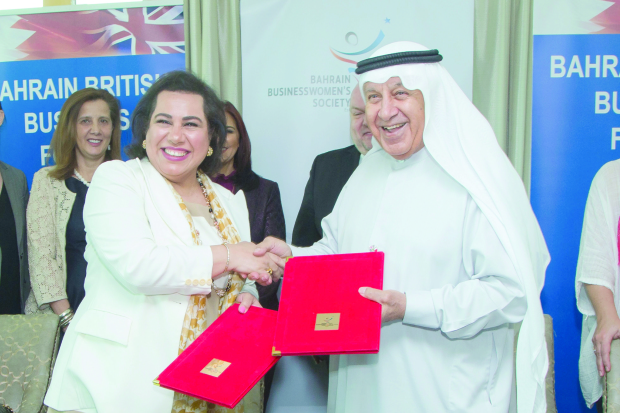 <p>An agreement was signed between the Bahrain British Business Forum (BBBF) and the Bahrain Business Women Society (BBWS), aimed at empowering women in business. The memorandum of understanding was signed between BBWS president Ahlam Janahi and BBBF chairman Khalid Al Zayani. The ceremony took place during a networking lunch organised by the BBBF's 'Women in Business' Special Interest Group in partnership with Euro Motors Jaguar Land Rover at the Capital Club to mark International Women's Day, and Bahraini and British Mother's Days, which all fall in March. Shura Council second vice-chairwoman Hala Ramzy Fayez was the guest speaker at the event which was attended by more than 80 BBBF and BBWS members and guests. During the lunch, a raffle with prizes donated by Euro Motors Jaguar Land Rover, was held. Above, Ms Janahi and Mr Al Zayani at the signing of the agreement. </p>