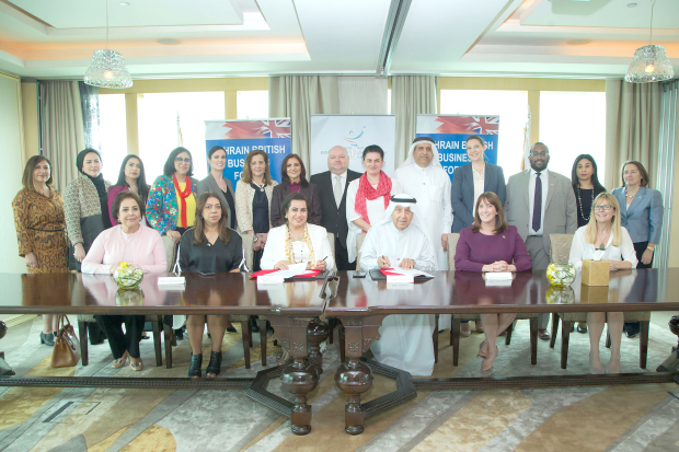 <p>Ms Janahi, seated, third from left, and Mr Al Zayani, seated, third from right, with BBBF and BBWS members.</p>