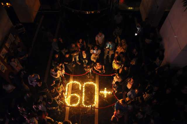 "<p><em>Guests, visitors, students and hotel officials mark Earth Hour.</em></p><p><br data-mce-bogus=""1""></p><p>The Gulf Hotel Bahrain Convention and Spa marked Earth Day by switching off all non-essential lights within the property for one hour. Guests, visitors, colleagues and Nadeen School students took part in various competitions held at the hotel during the hour. The hotel also reached out to in-house guests with assistance from the students, who spread their environmental message through poetry, songs and posters. Above, guests, visitors, students and hotel officials mark Earth Hour.</p>"