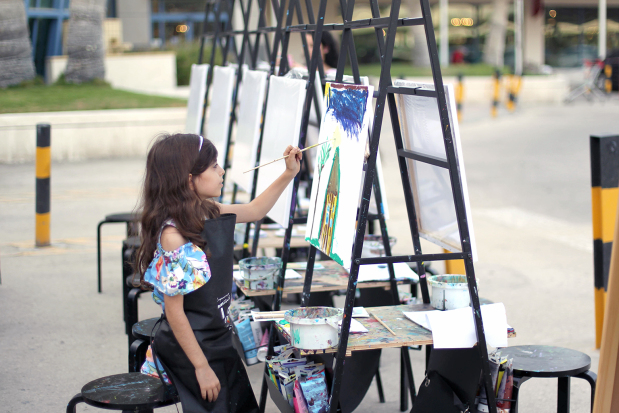 A young artist displays her talent