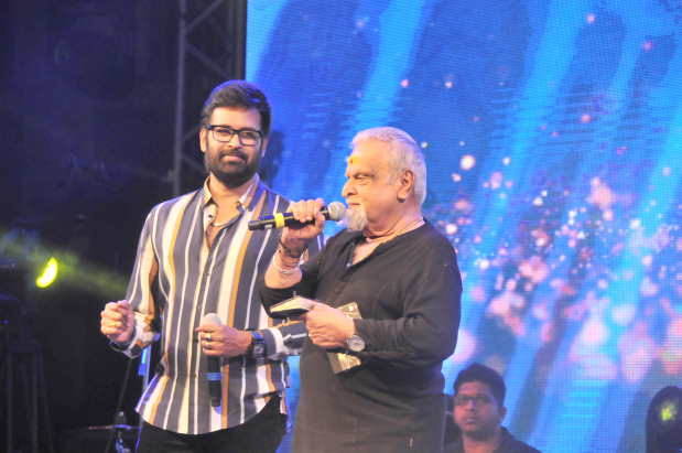 Renowned south Indian singer P Jayachandran performs as film actor Manoj K Jayan looks on. Below, a section of the audience.