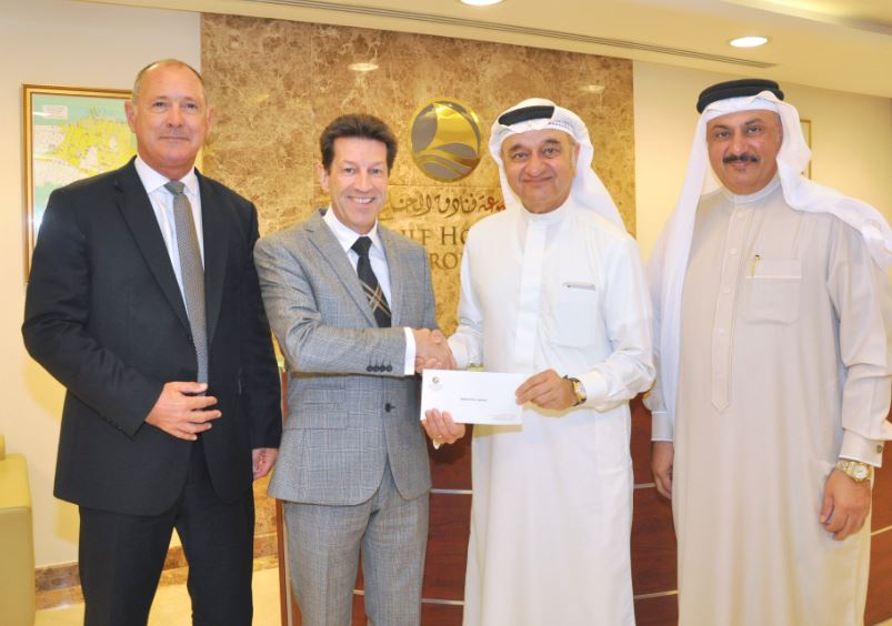 <p>Gulf Hotels Group presented its annual donation of BD2,000 to the Bahrain Down Syndrome Society as part of its ongoing efforts to support charitable community institutions in the country. Group chief executive Garfield Jones handed over a cheque to society chairman Adel Abdulla Fakhro in the presence of society treasurer Ahmed Abdulrahman Al Ali and group deputy chief executive Ron Peters. At the presentation are, from left, Mr Peters, Mr Jones, Dr Mahmoud and Mr Al Ali.</p>
