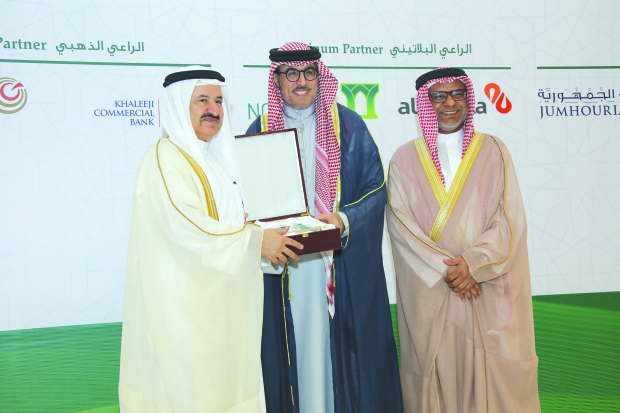 "The AAOIFI honoured Kuwait Finance House Group (KFH) in recognition of its sponsorship of the 17th annual Sharia Boards Conference held in Bahrain. KFH-Bahrain managing director and chief executive Abdulhakeem Al Khayyat received the honorary shield. ""We are pleased to continue to collaborate with the AAOIFI conference, which sets Sharia standards for Islamic financial institutions. This partnership comes in line with the bank's strategy, which focuses on elevating the standards of Islamic banking in Bahrain,"" he said. Above, Mr Al Khayyat, centre, receiving the shield."