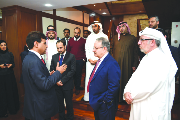 "Ithmaar Bank, a Bahrain-based Islamic retail bank, has launched a new employee training and compliance initiative aimed at bolstering compliance with regulatory rules and guidelines across the organisation. The Compliance Champions programme will see 48 members of staff from different departments undergo in-house training sessions alongside customised courses. ""Compliance is a cornerstone of the banking industry and a prerequisite for delivering quality service to clients,"" said chief executive Ahmed Abdul Rahim. Representatives from the bank's compliance and anti-money laundering department will conduct in-house sessions while other customised courses will be provided by external training providers. Above, Mr Abdul Rahim with other officials."