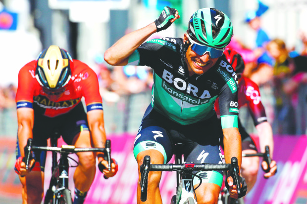 Benedetti wins Giro d'Italia 12th stage, Polanc takes pink jersey
