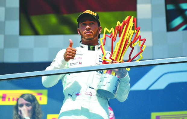 Hamilton claims 'bizarre' victory; Vettel demoted to second after being handed penalty